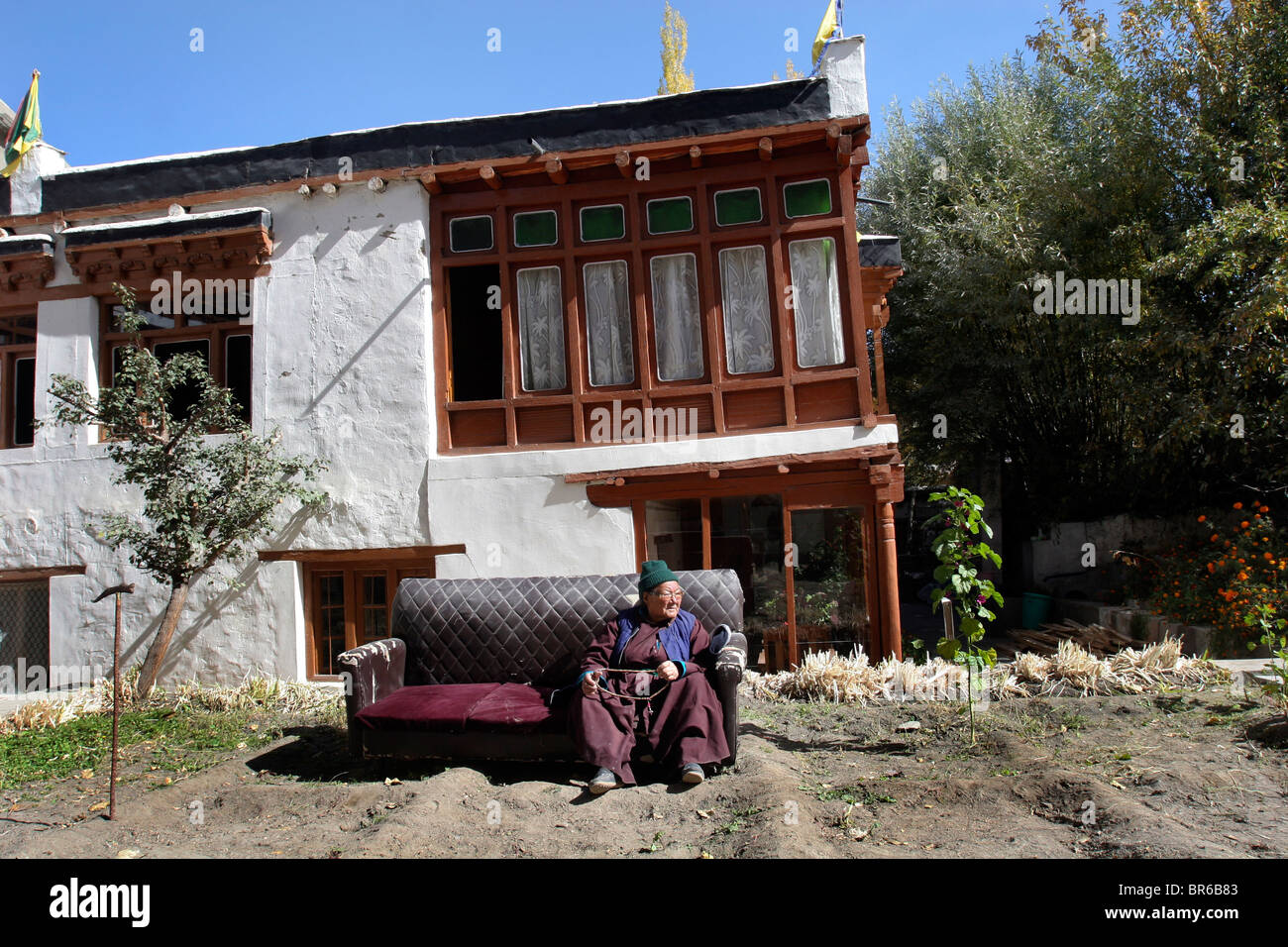 Old Woman Outside House India Stock Photos & Old Woman Outside House India Stock Images - Alamy