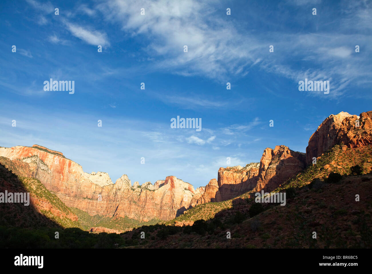 Early morning light and wispy clouds in Zion Canyon National Park. - Stock Image