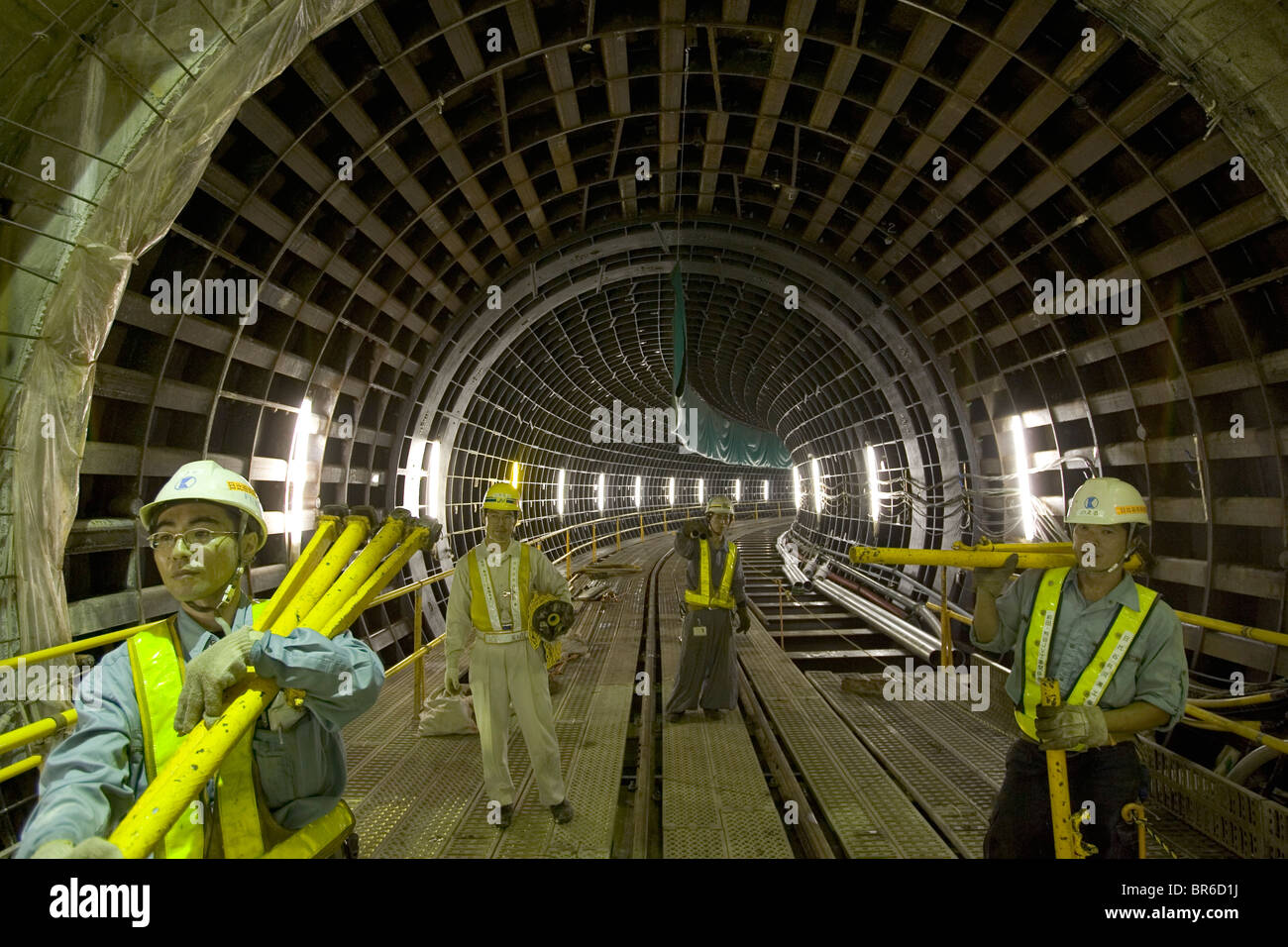 Workers in common utility duct Tokyo Japan. - Stock Image