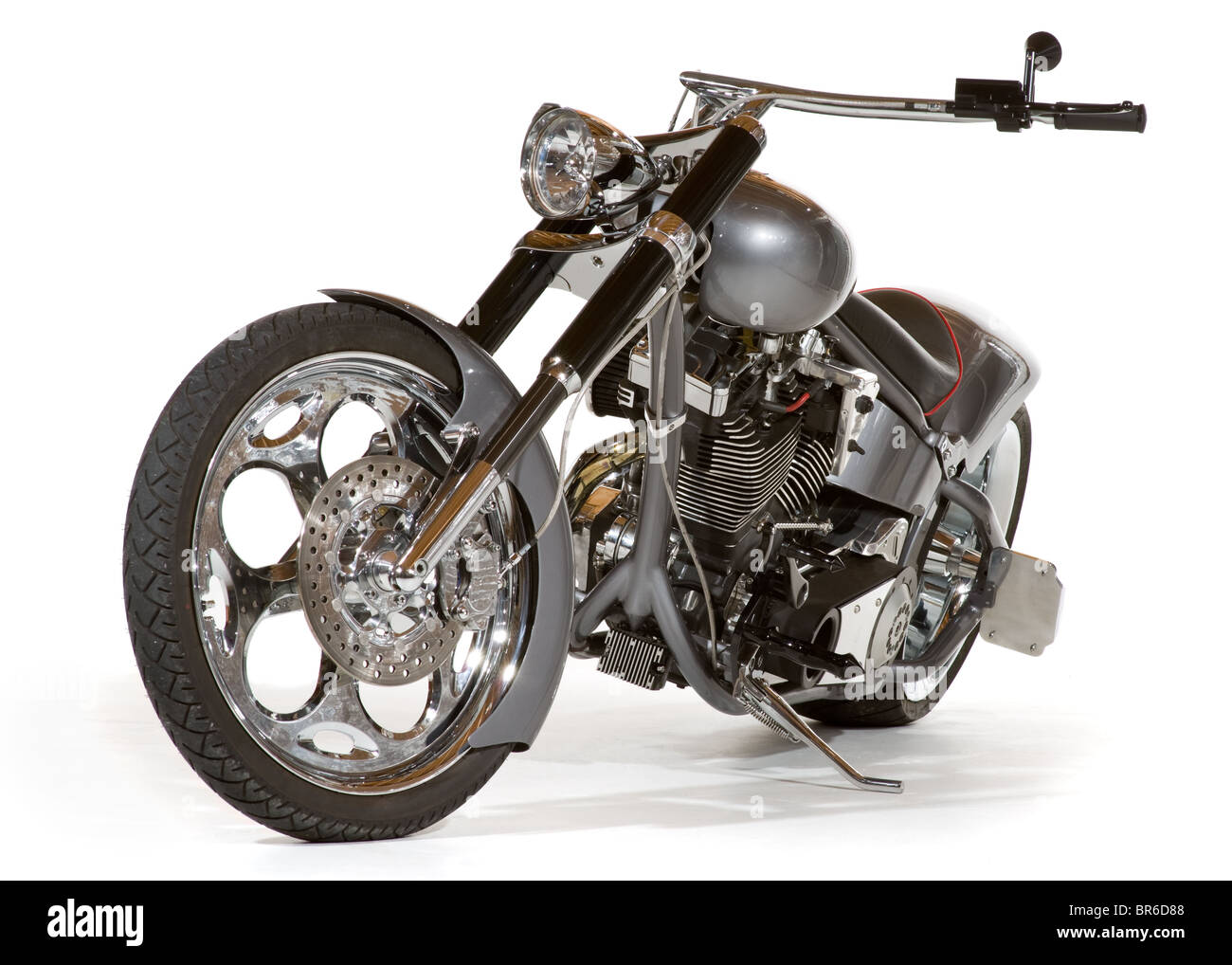 Custom chopper motorcycle seen from a low angle oblique view. Studio shot isolated on white background. - Stock Image