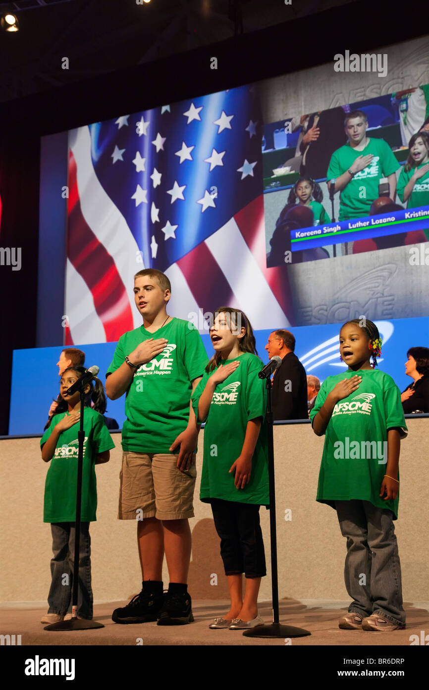 Boston, Massachusetts - Children lead the Pledge of Allegiance at the convention of the public employees union AFSCME. - Stock Image