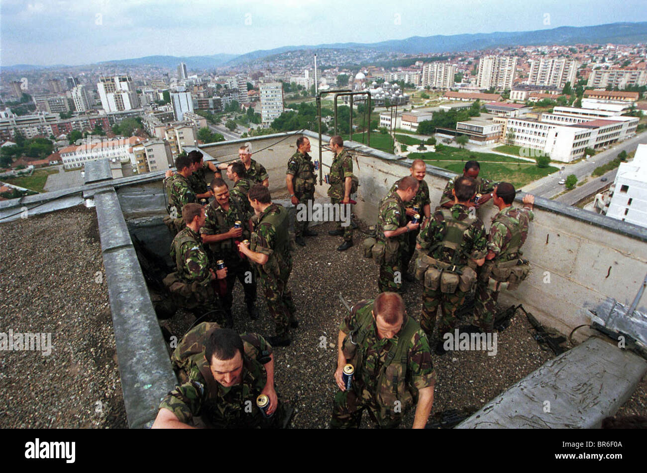 British Paratroopers socialize after a rooftop award ceremony in Pristina, Kosovo. Stock Photo