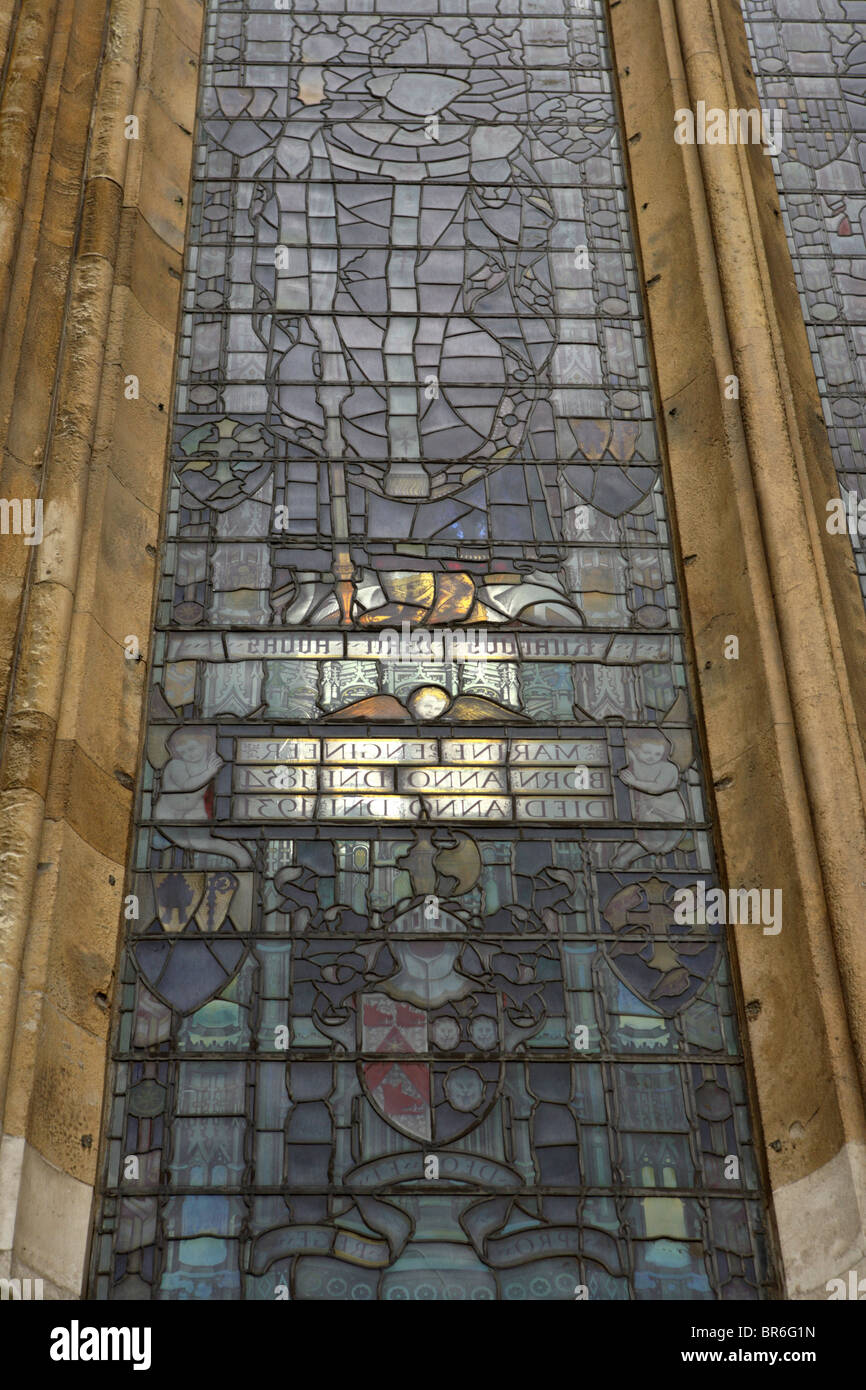 Light coming through a stained glass window viewed from the outside on Westminster Abbey, Westminster, London, SW1. - Stock Image