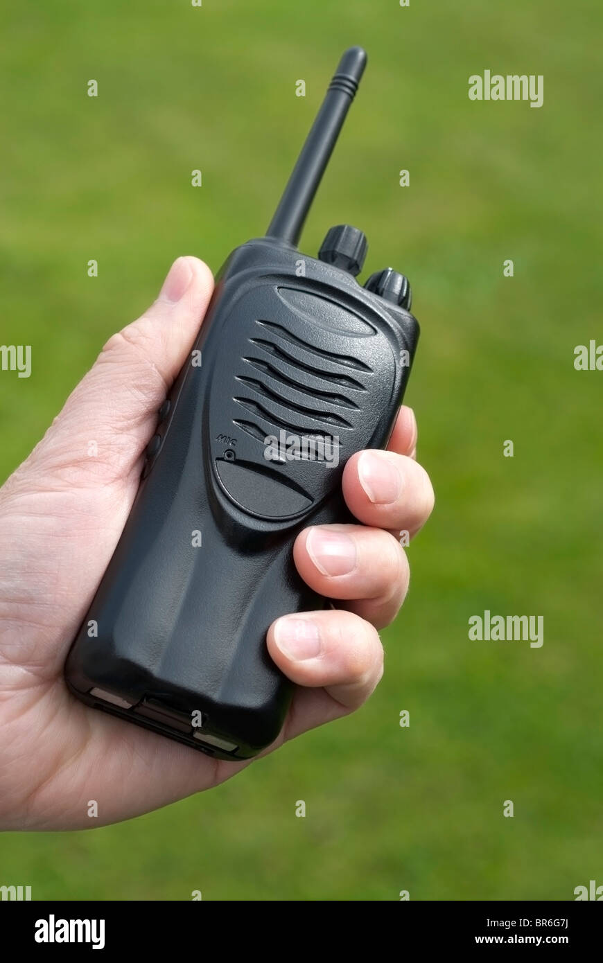 Hand Holding Walkie Talkie - Stock Image