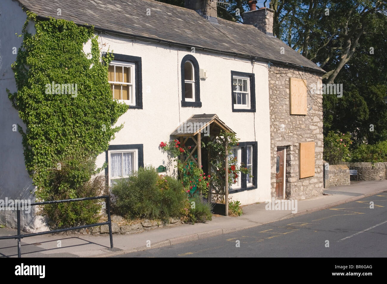 Typical English country cottage in the village of Warton, Lancashire, England. - Stock Image