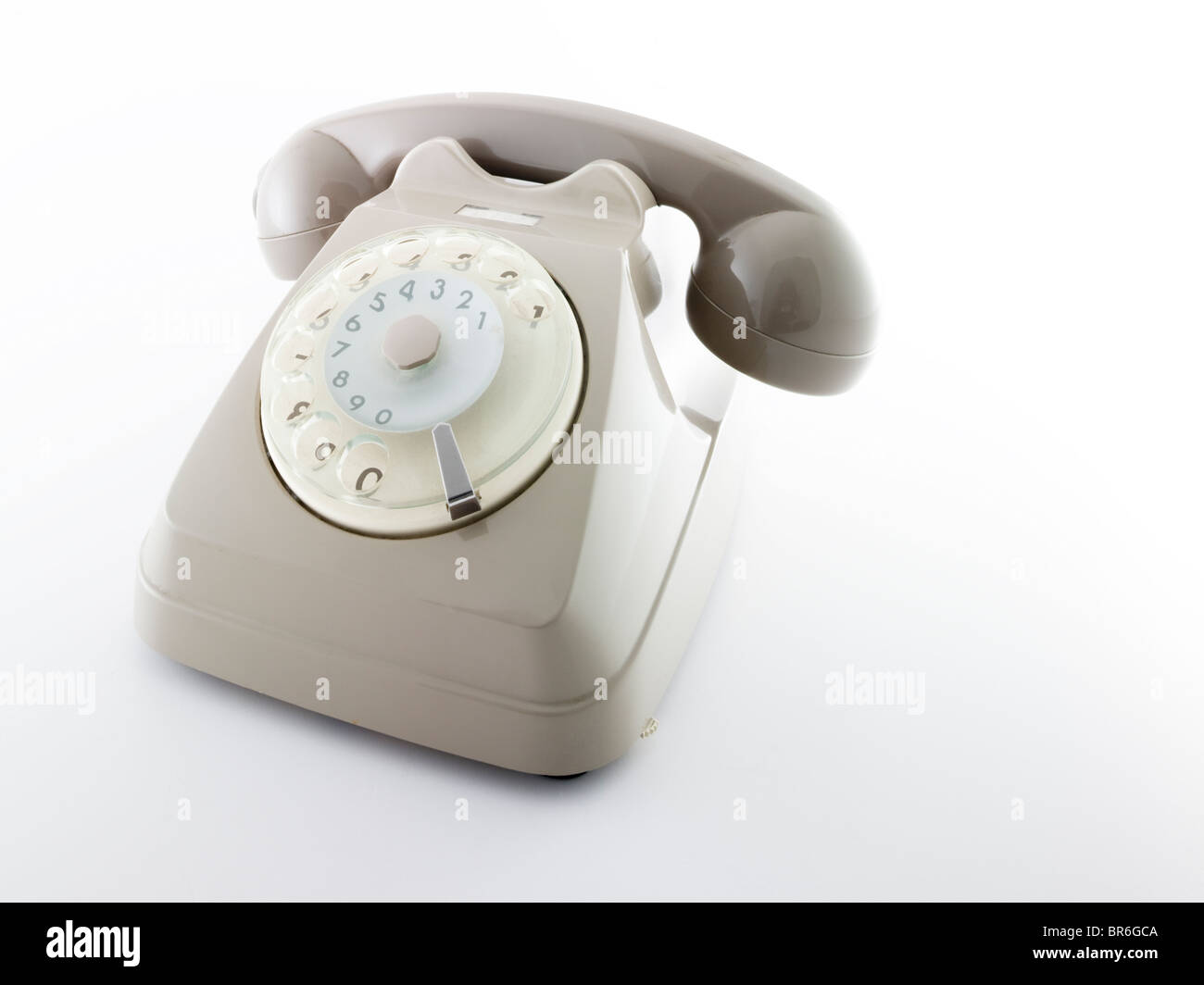old rotating dial telephon over a white background - Stock Image