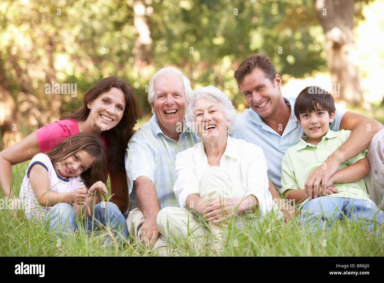 Portrait Of Extended Family Group In Park - Stock Image