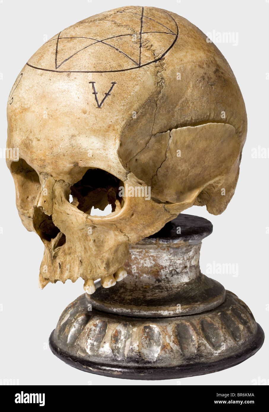 A ceremonial plumb bob and skull of a freemason lodge, German, 19th century. Elaborately crafted, knobbed brass Stock Photo