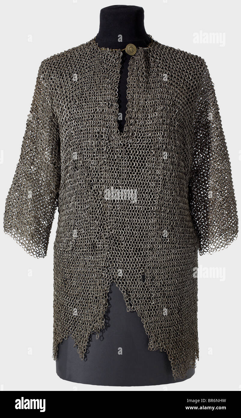 A chain mail shirt, Central Europe, circa 1500. Mail of flattened, riveted rings with round rivet heads. Hip-length - Stock Image