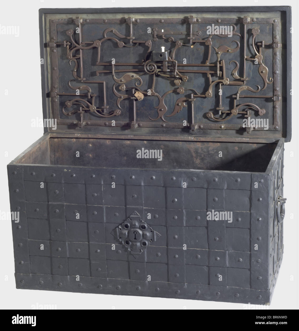 A large German war chest, 1st half of the 17th century. Iron chest reinforced with straps. Lateral handels and a - Stock Image
