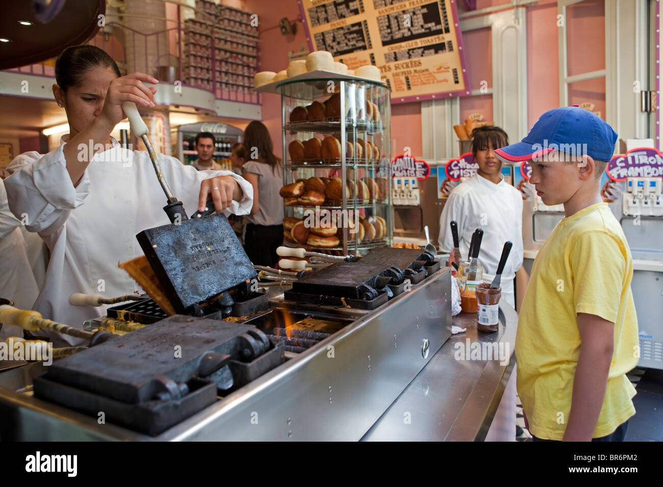 Model-released Boy waiting for freshly made waffle - Stock Image