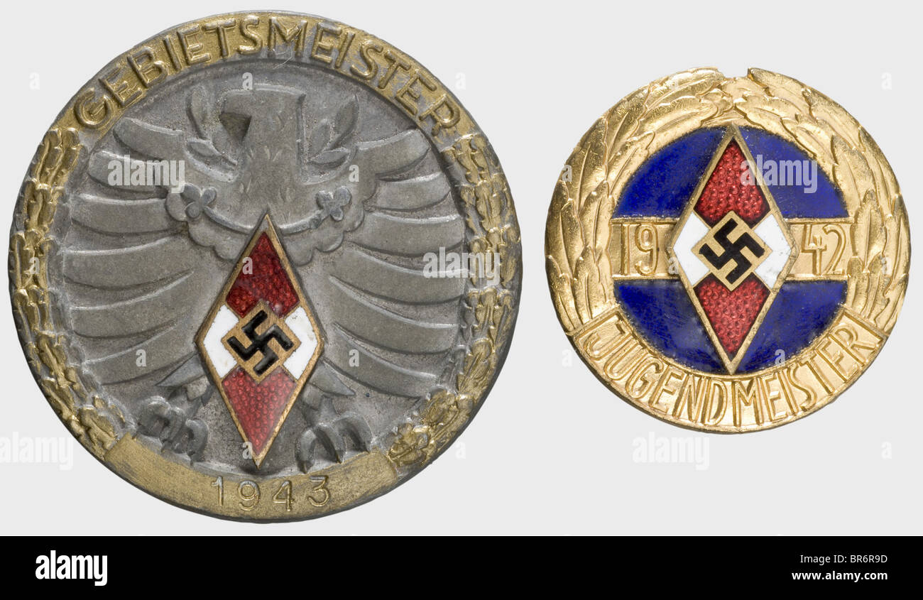 A Hitler Youth Champion's Honour Badge in Gold 1942., Gilt iron and blue enamel, applied HJ badge, lateral attachment - Stock Image