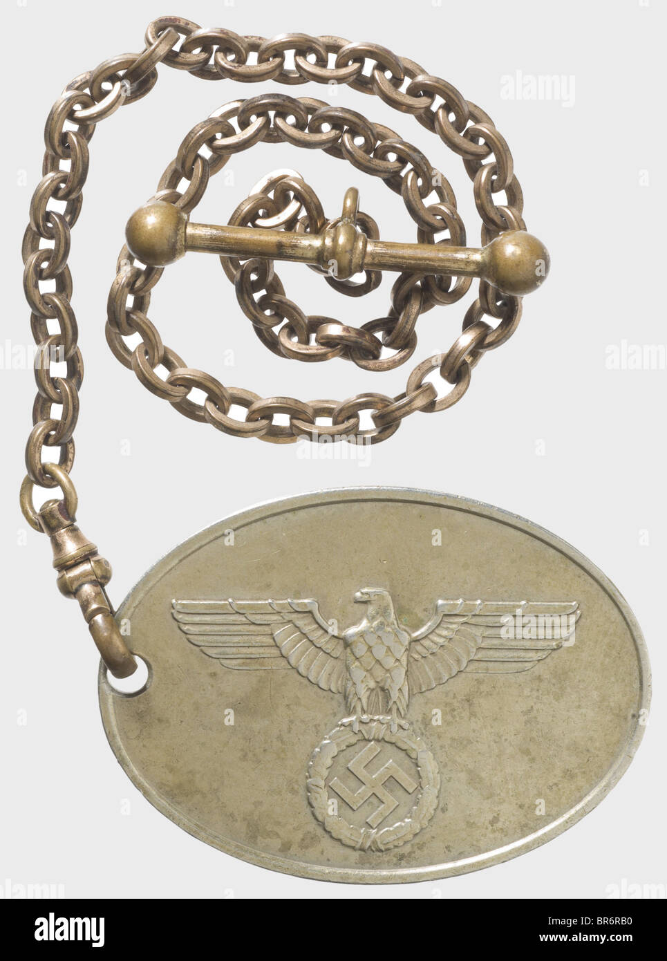 "A badge ""7674"" of the GESTAPO., Nickel-silver, raised national eagle and the inscription ""GEHEIME STAATSPOLIZEI"" Stock Photo"