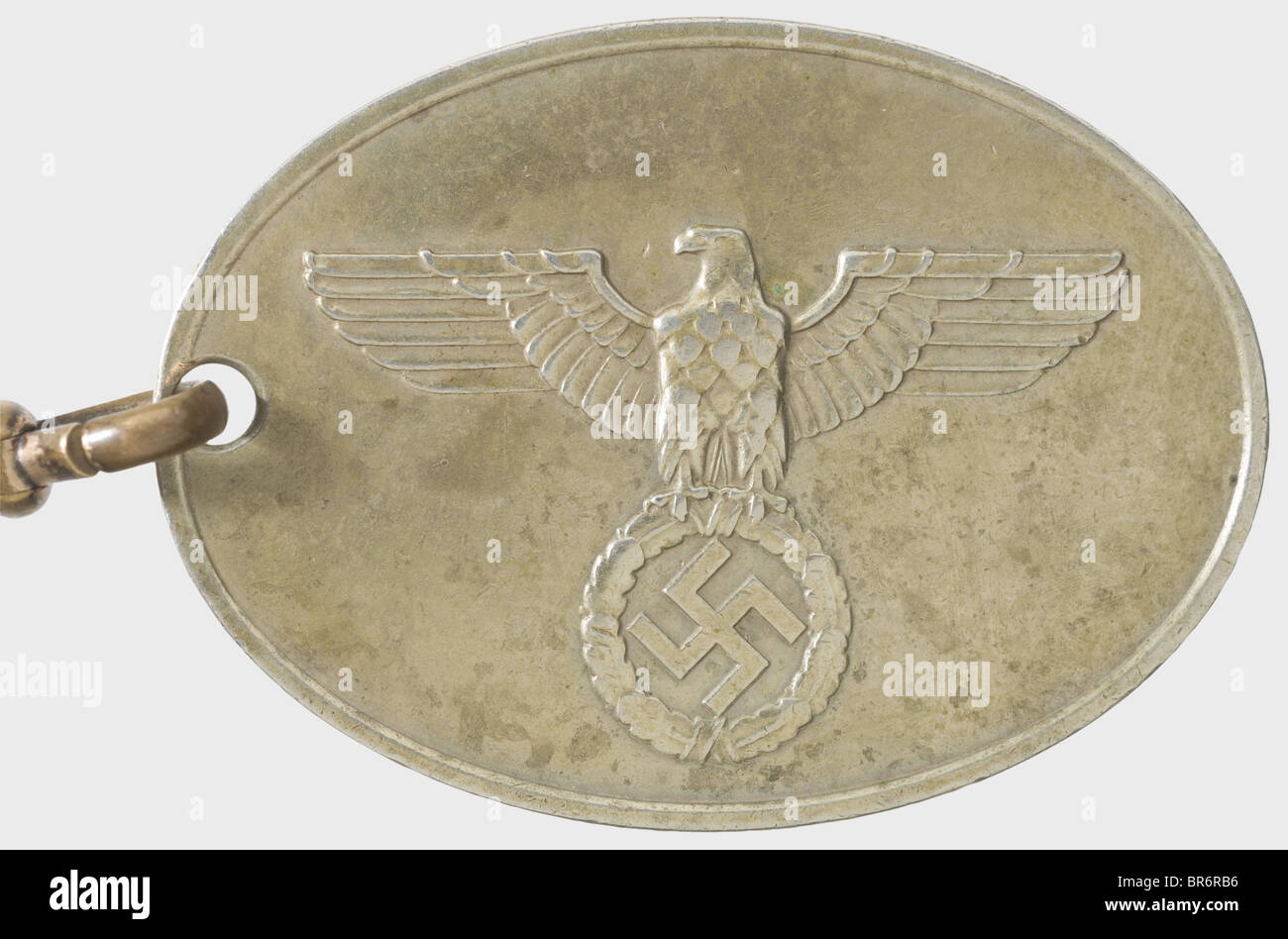 """A badge """"7674"""" of the GESTAPO., Nickel-silver, raised national eagle and the inscription """"GEHEIME STAATSPOLIZEI"""" Stock Photo"""