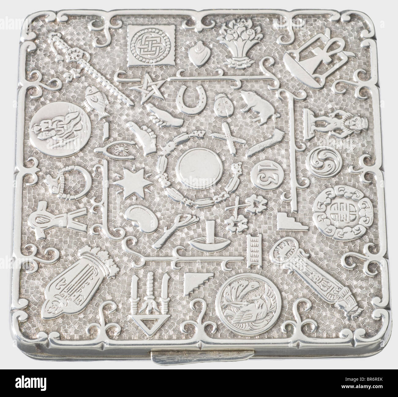 A silver cigarette case., The entire top and bottom side covered with signs of the zodiac and magical symbols in - Stock Image