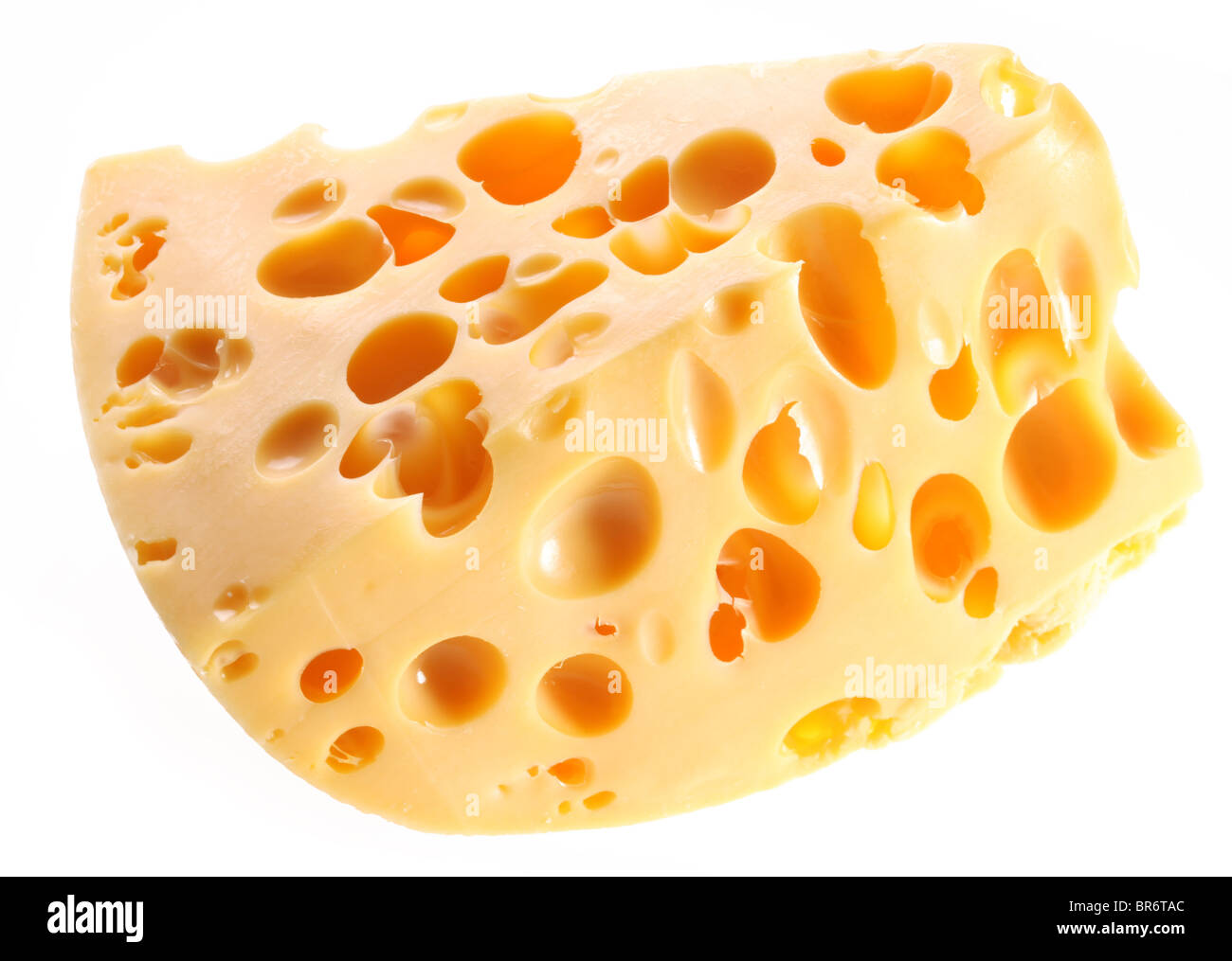 Piece of Swiss cheese on a white background. - Stock Image