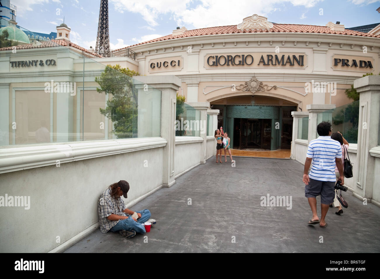 A beggar asking for money on the Strip, - concept rich and poor in america;  Las Vegas USA - Stock Image