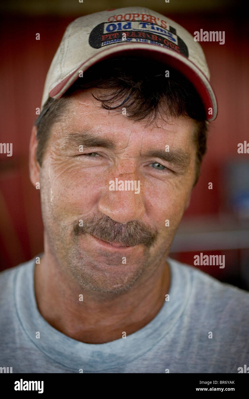 A male chef at a Texas barbeque restaurant Llano Texas. - Stock Image