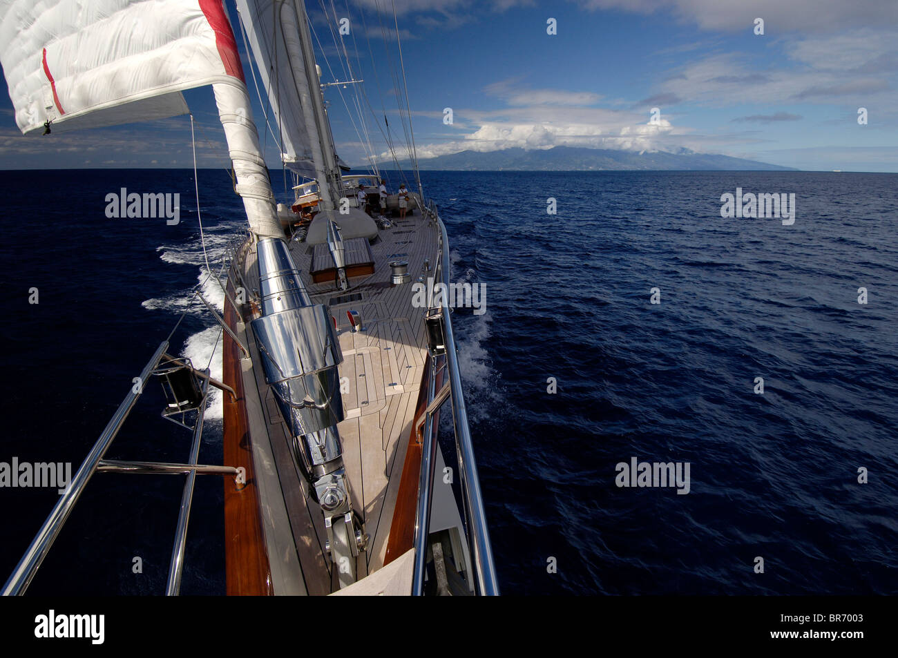 Dramatic photo taken from the bow of SY 'Adele', 180 foot Hoek Design, sailing in French Polynesia, 2006. - Stock Image