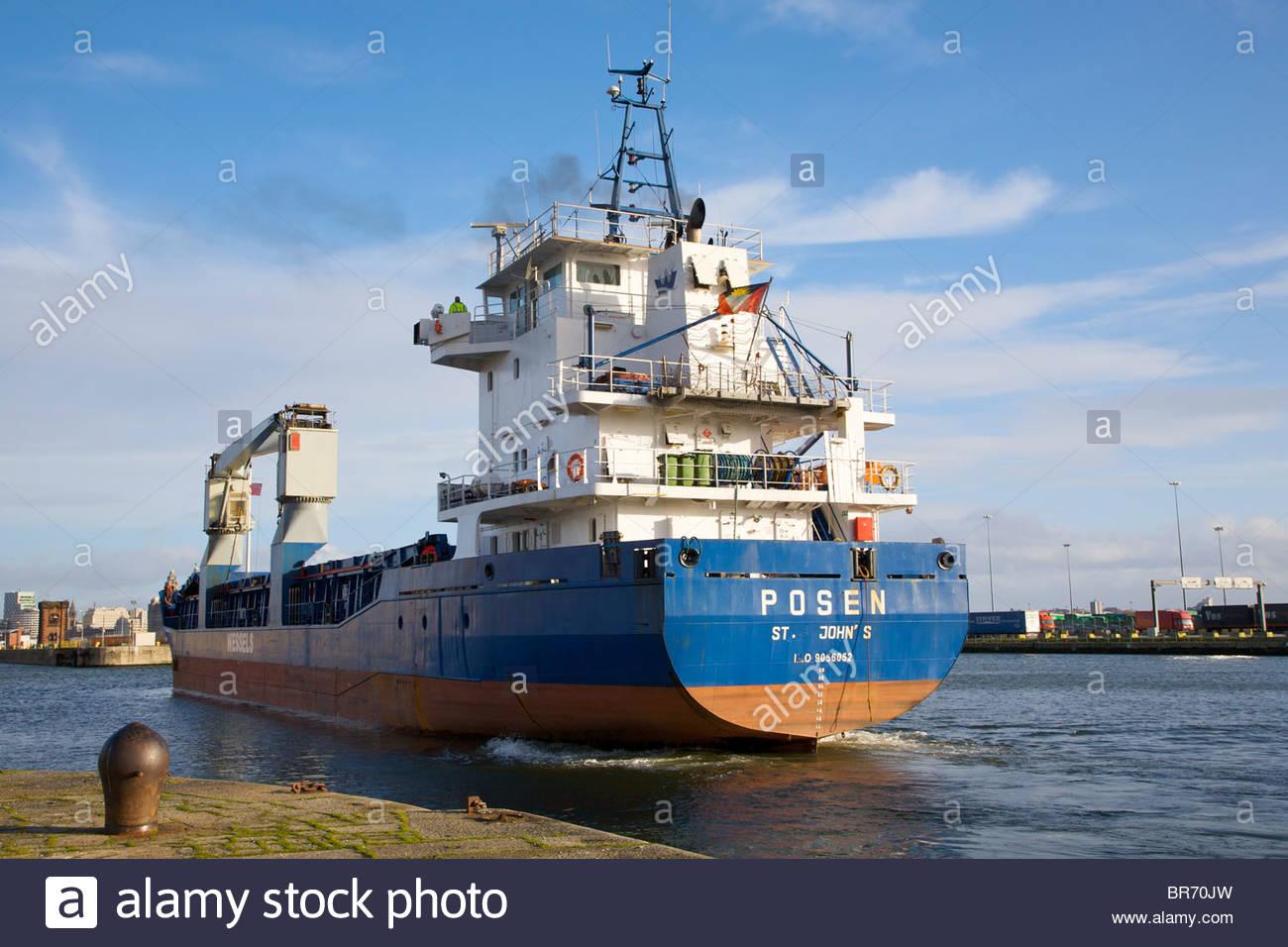 Cargo vessel 'Posen', built in 1993, leaving Birkenhead dock system, Merseyside, UK. February 2009. - Stock Image