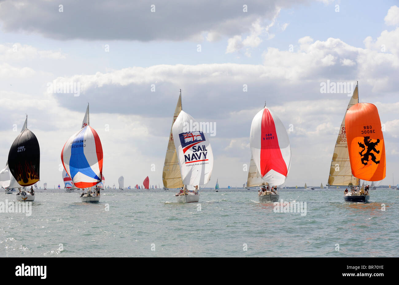 Fleet racing at Cowes Week, including 'Sixes and Sevens', 'Tactix', 'Sail Navy Gauntlet', - Stock Image