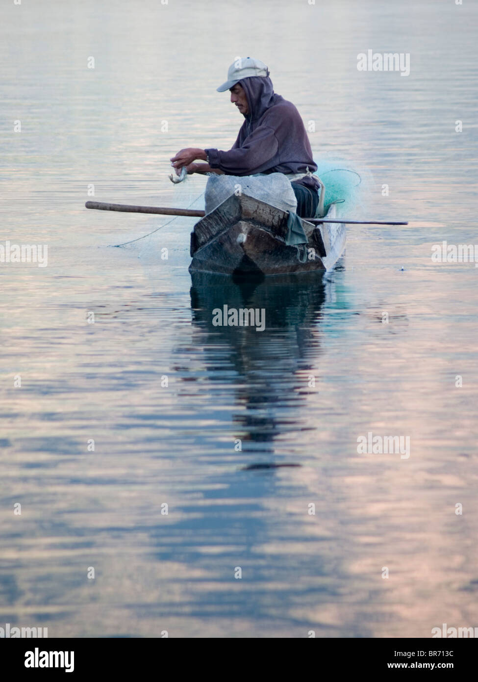 Fresh water fishermen at work on Lake Atitlan in Santiago Atitlan Guatemala. - Stock Image