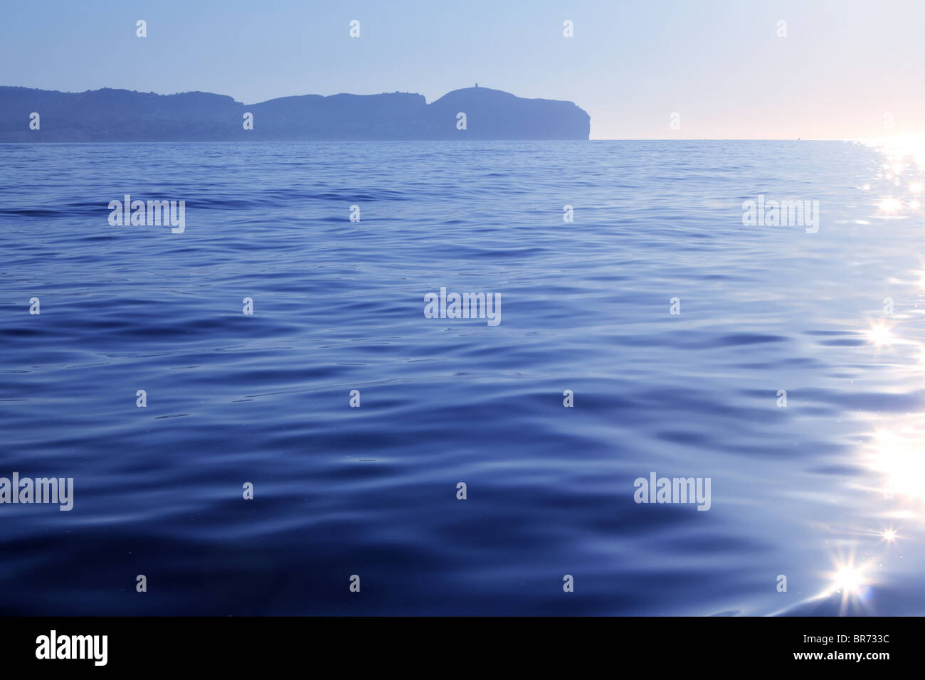 Nao Cape far view blue reflection water Alicante province Spain - Stock Image