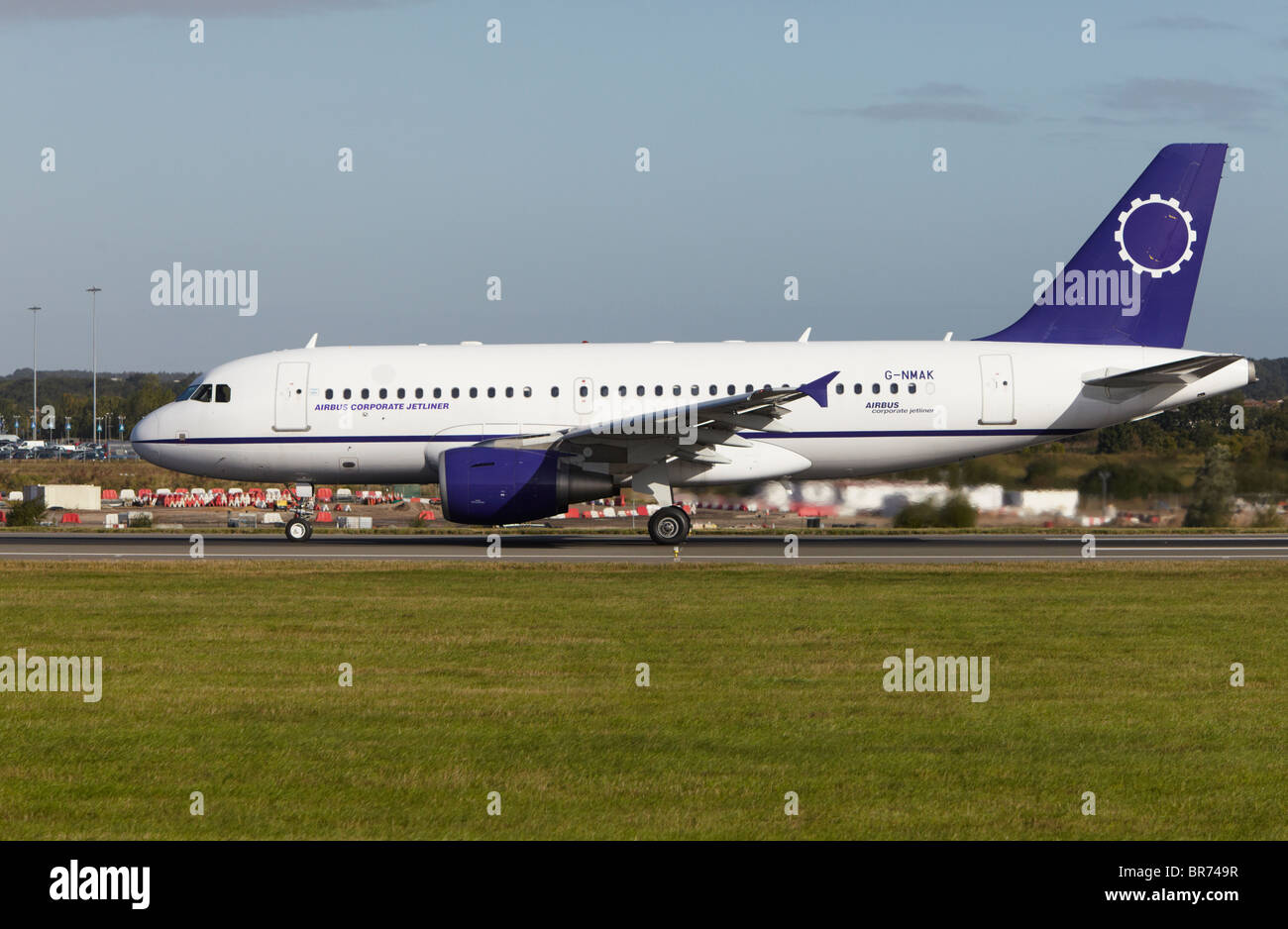 Twin Jet Airbus A319-133X taking off at Luton Airport, Bedfordshire, England, United Kingdom - Stock Image