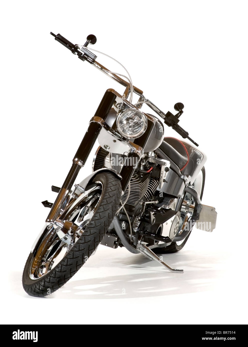 High end custom chopper motorcycle, seen from the front with handlebar and wheel turned toward the viewer. Isolated. - Stock Image