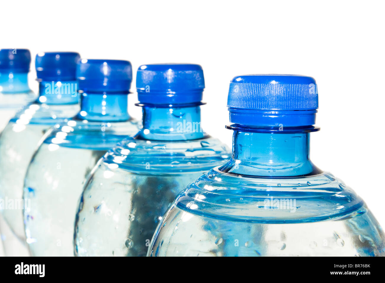 A row of bottles of water isolated on white Stock Photo