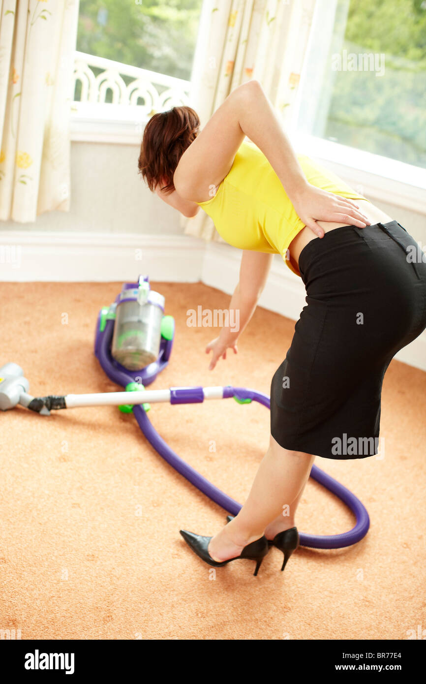 Woman with aching back - Stock Image
