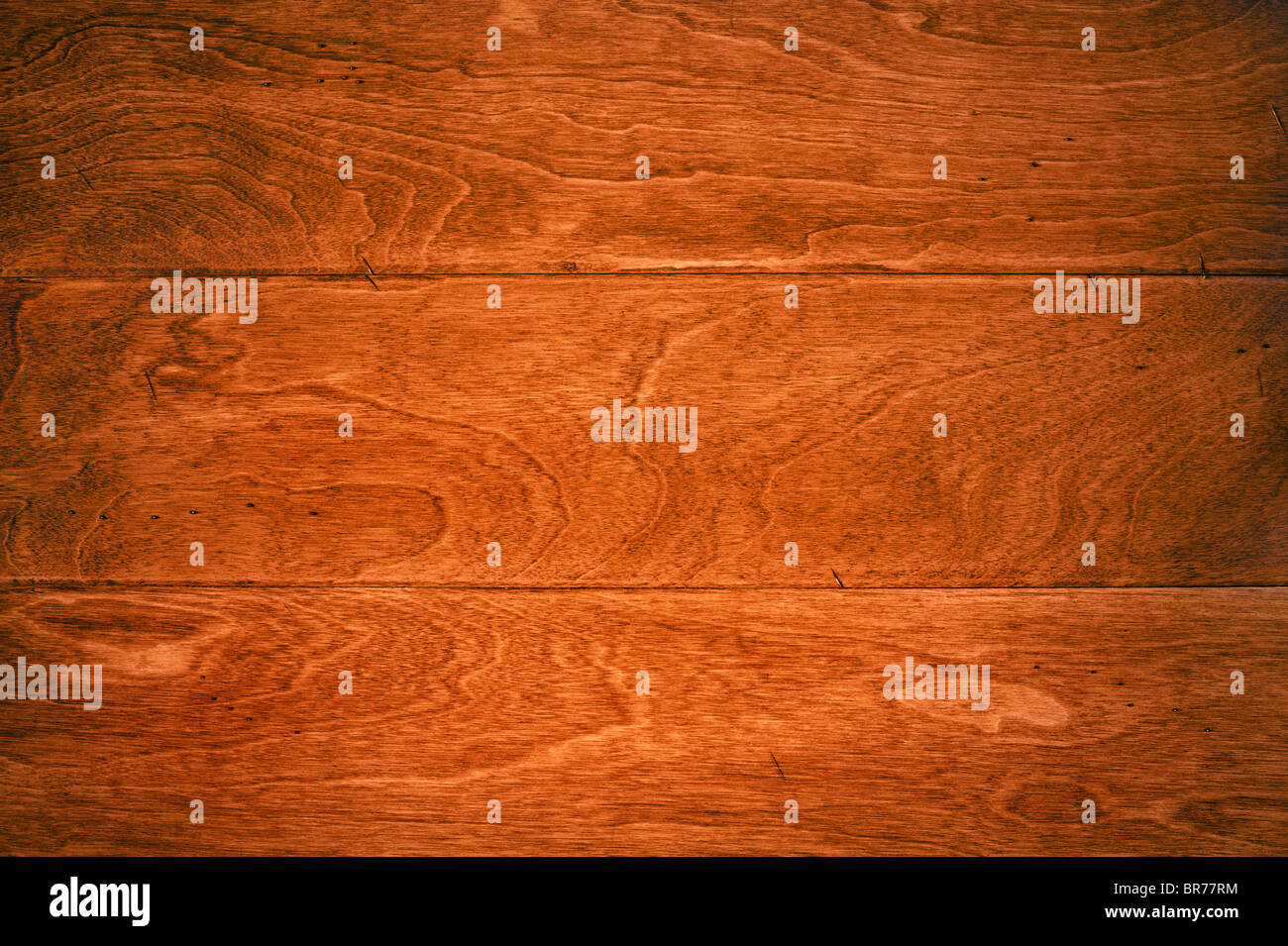 A beautiful deep, rich hardwood floor with its wood grain details for use as and background or appropriate housing - Stock Image