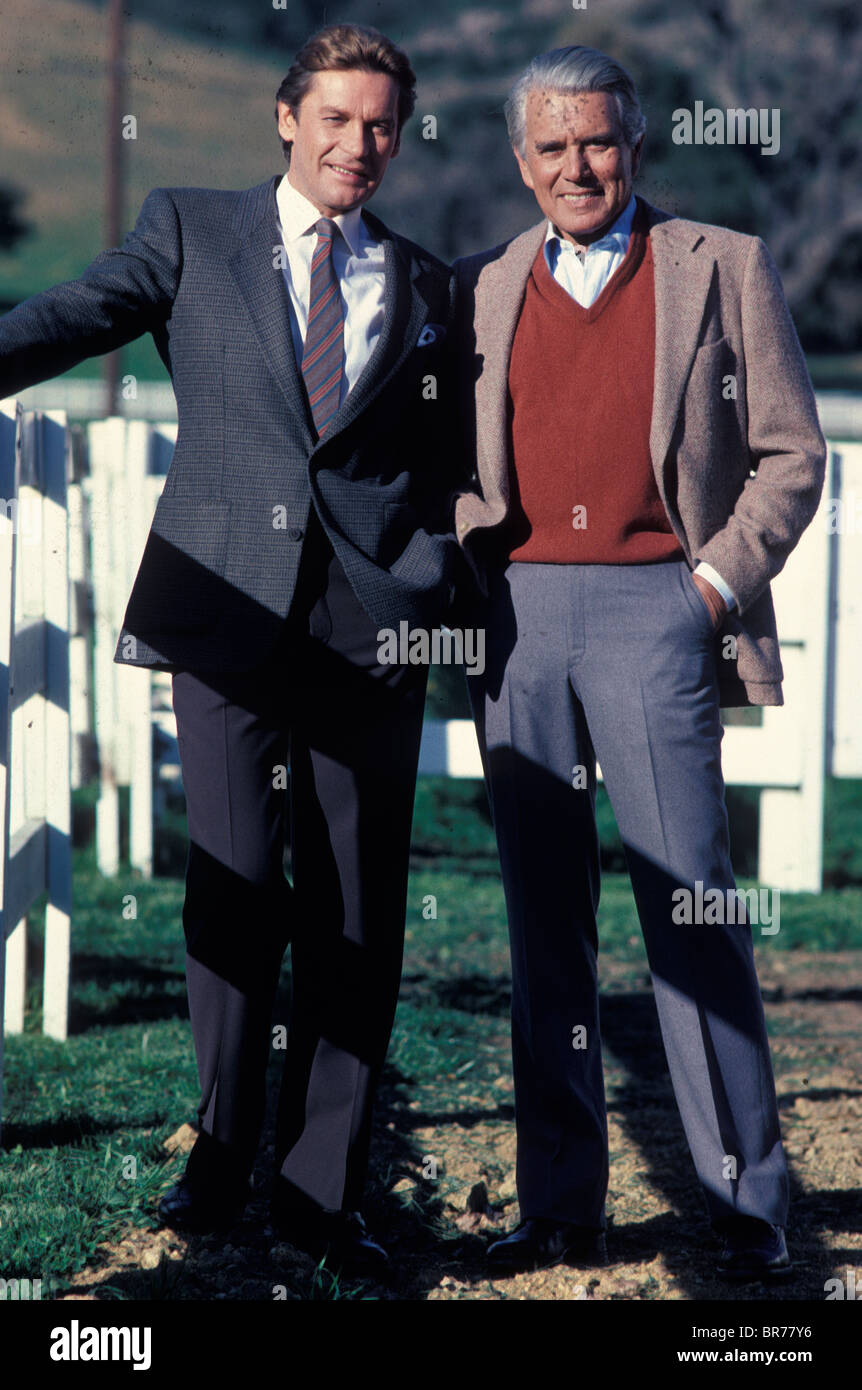 Actor John Forsythe with co-star German actor Helmut Berger on the set of TV soap opera series Dynasty in 1983 California - Stock Image