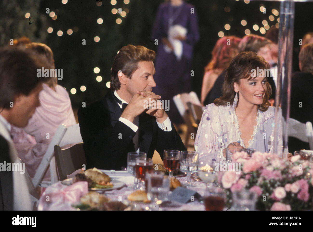 Actor Helmut Berger and actress Pamela Sue Martin on film set of popular soap opera television series Dynasty Hollywood - Stock Image