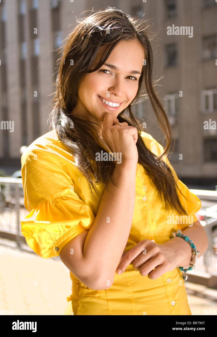 Closeup portrait of a laughing young pretty girl - Stock Image