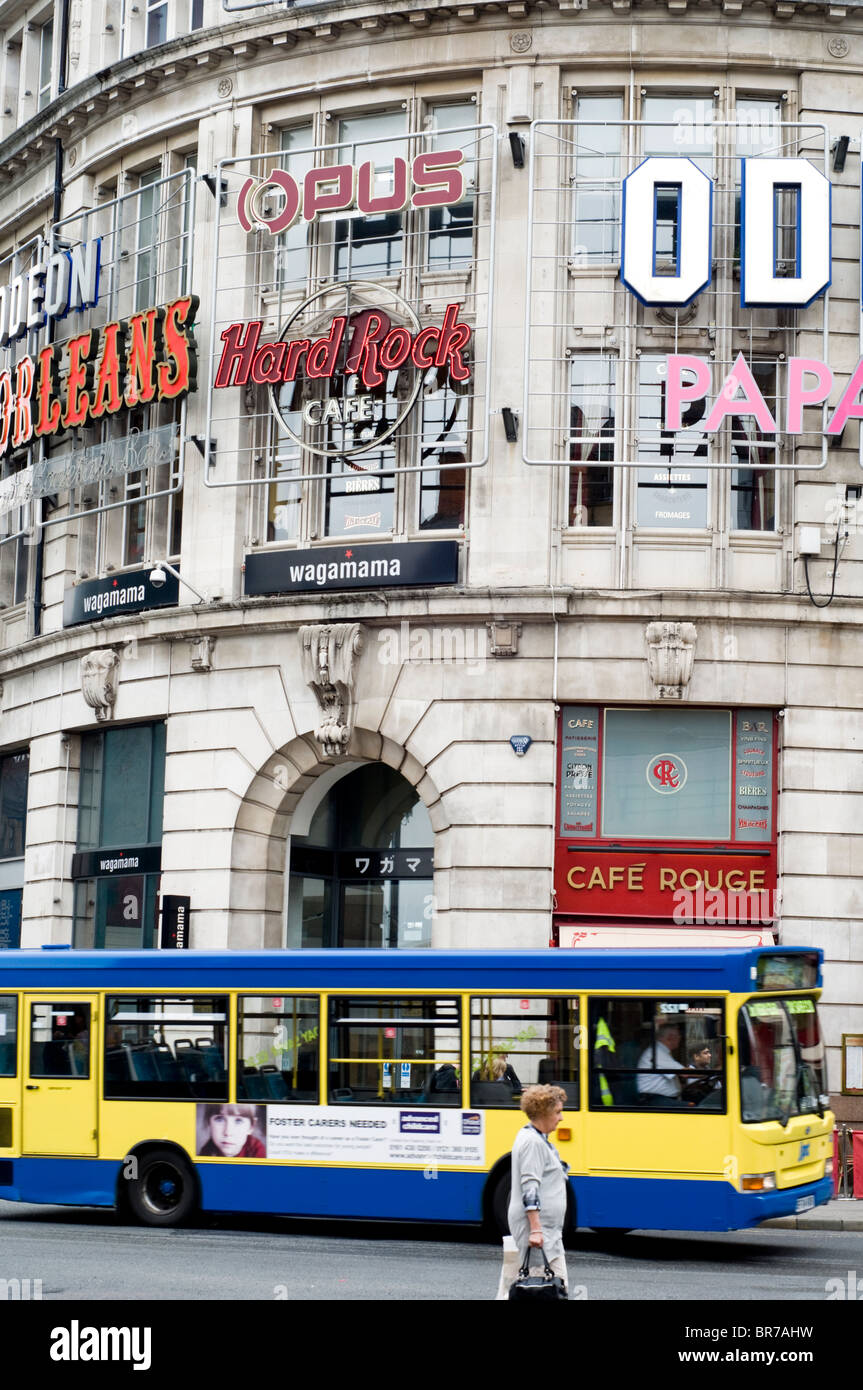 Bus in front of the Printworks building in Manchester city centre, England, UK - Stock Image