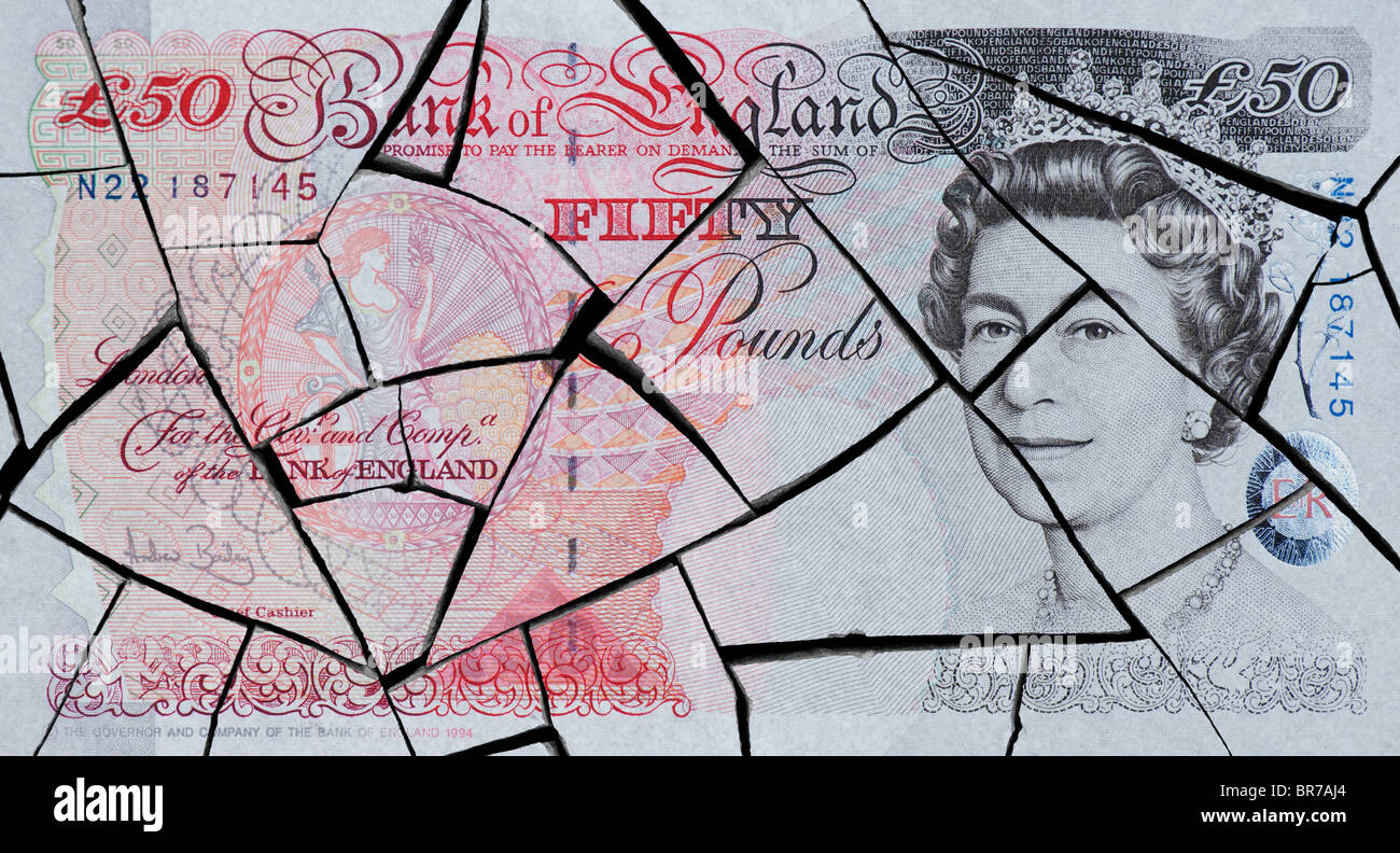 Cracked fifty pound note concept to represent an economic crisis - Stock Image