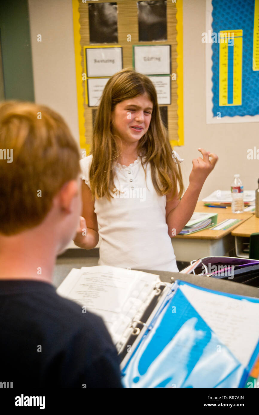 An unprepared middle school student seems unsure of herself during a debate before classmates in San Clemente, CA. - Stock Image