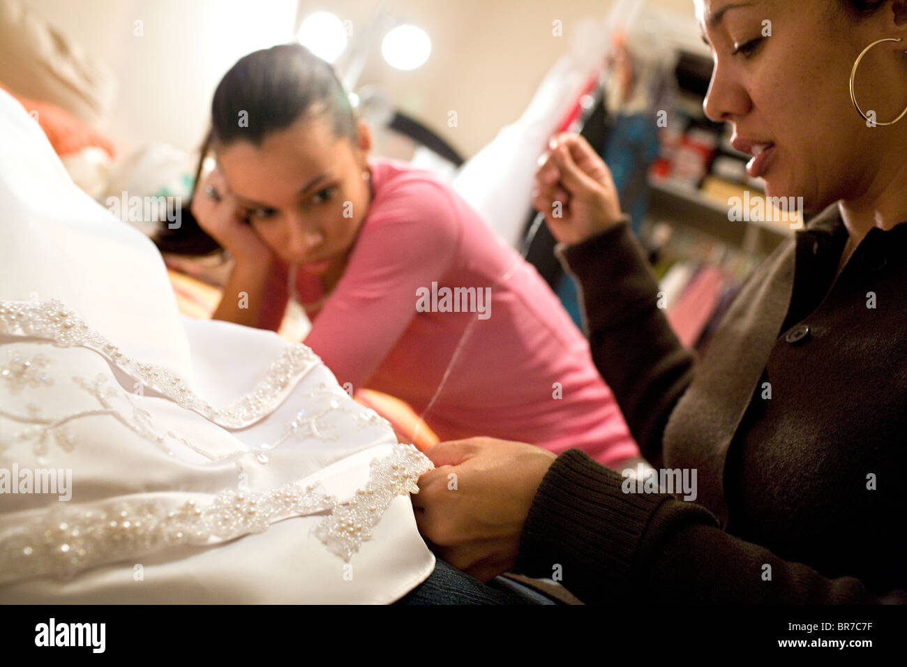 Preparing a gown for a New Orleans debutante ball Stock Photo ...