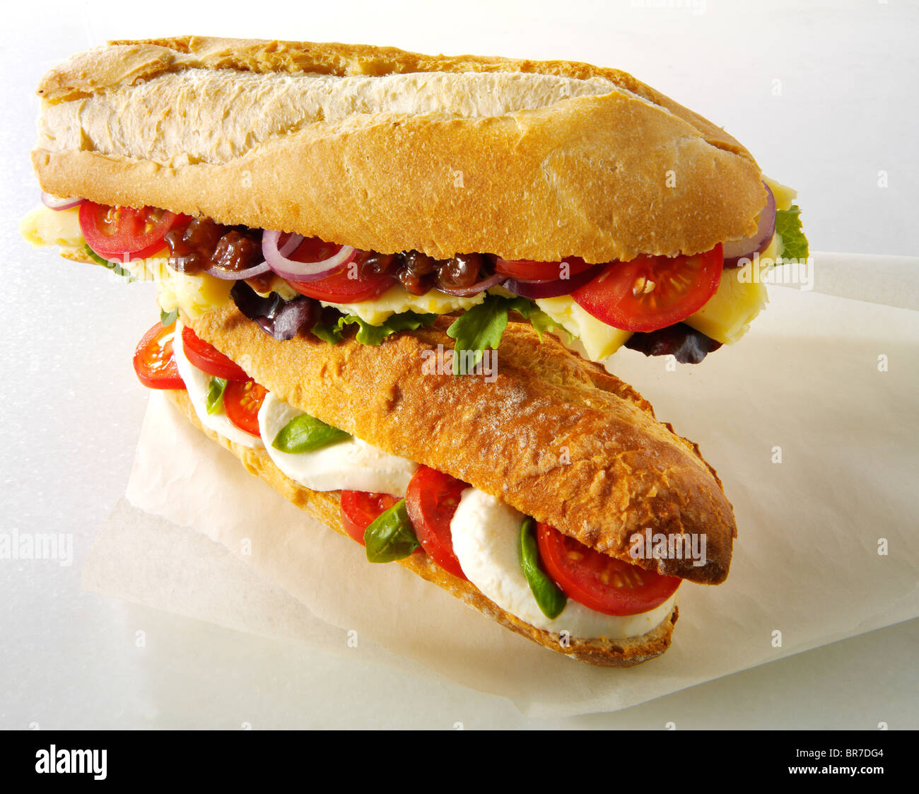 Bread baguettes filled with mozerella & tomatoes, and cheddar ploughmans with chutney - Stock Image