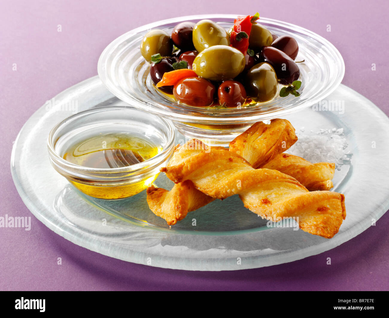 bowl of mixed olives with bread sticks Stock Photo