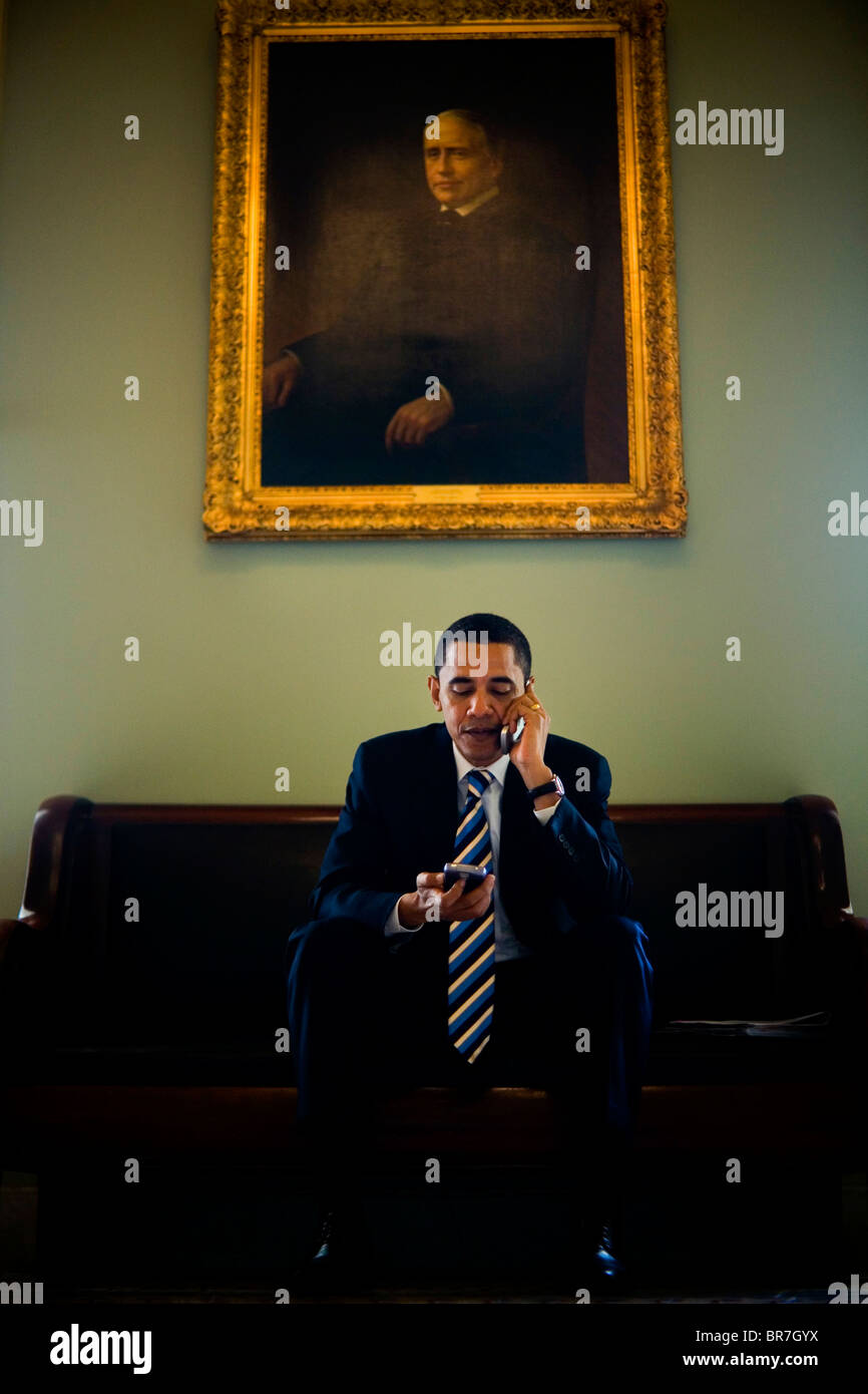 Barack Obama talks on a cell phone outside the Senate chambers of the U.S. CapitolStock Photo