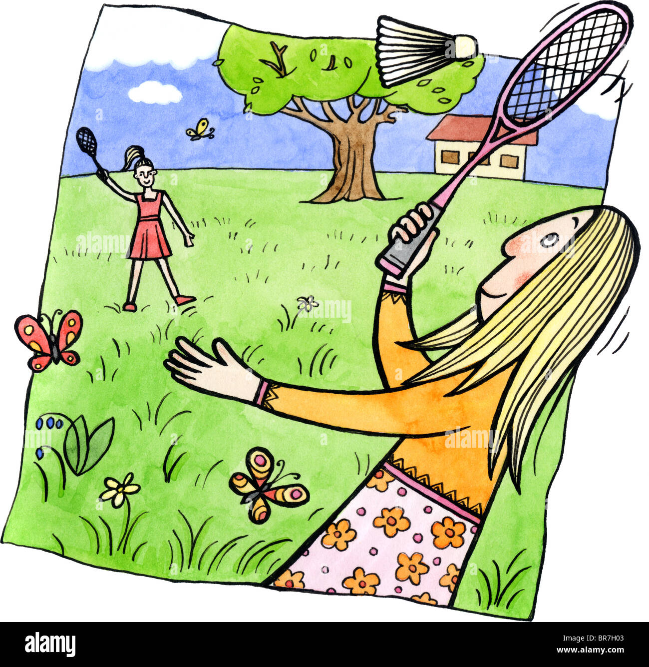 Two women playing badminton outdoors Stock Photo