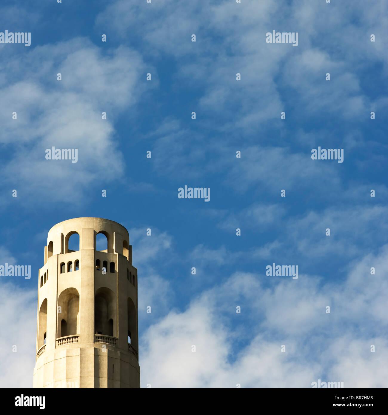 Coit Tower San Francisco CA. against blue cloudy sky. Stock Photo