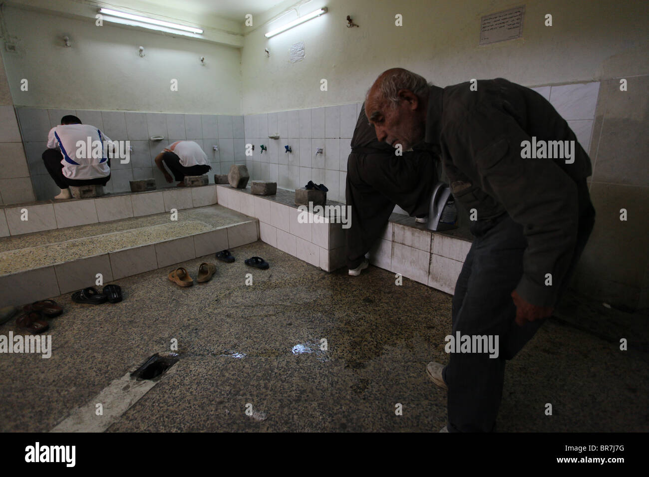 Kurdish men washing their feet in a public bathroom in Qaysari bazaar in the city of Erbil also spelled Arbil or - Stock Image