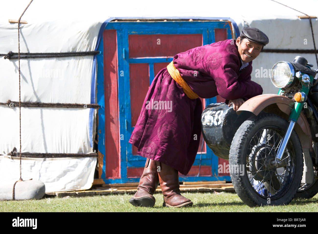Mongolian nomad in a front of his yurt - Stock Image