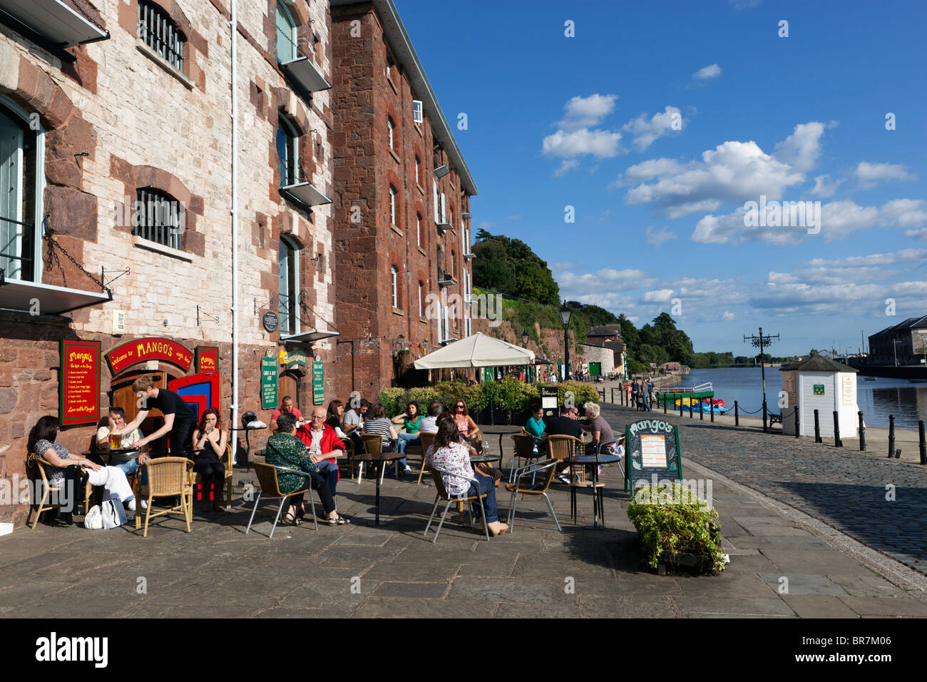 Former riverfront warehouses, now cafés, at The Quayside in Exeter - Stock Image