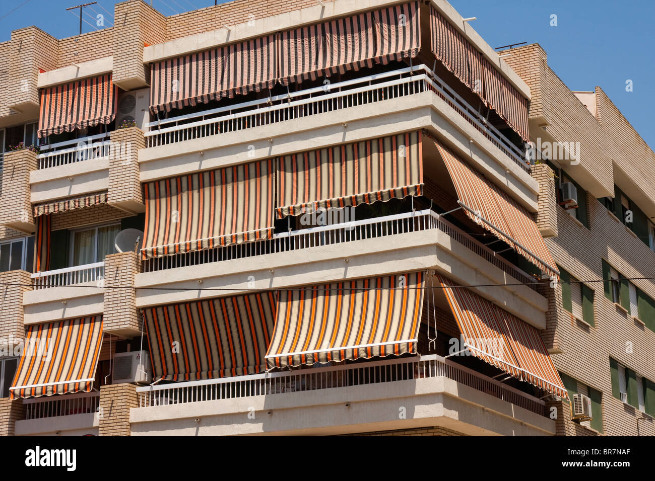 Balconies covered by sun shades during the heat of the day