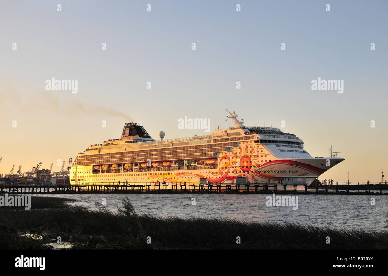 Norwegian Sun Cruise Ship, glowing in the evening sun, seen from the Costanera Ecologica Reserva Sur, River Plate, - Stock Image