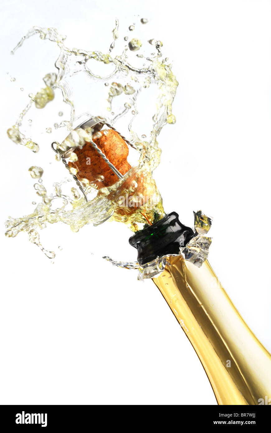 Extreme close-up image of explosion of champagne bottle cork - Stock Image